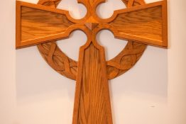 wooden cross above altar